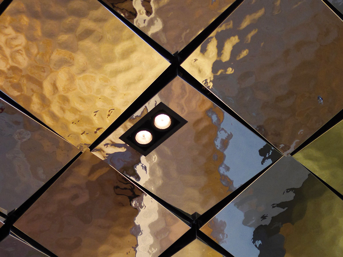 The High Gloss Surface Made Of Hammered Stainless Steel Gives A Special Three Dimensional Character To Your Metal Ceiling Combination Perforation And